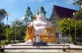 """Budai (Chinese: 布袋; pinyin: Bùdài), pronounced Hotei in Japanese, Bố Đại in Vietnamese, is a Chinese folkloric deity. His name means """"Cloth Sack"""" and comes from the bag that he is conventionally depicted as carrying. He is usually identified with (or as an incarnation of) Maitreya Buddha, so much so that the Budai image is one of the main forms in which Maitreya Buddha is depicted in East Asia. He is almost always shown smiling or laughing, hence his nickname in Chinese, the Laughing Buddha (Chinese: 笑佛; pinyin: xiàofó). Many people confuse Budai with Gautama Buddha.<br/><br/>  Trang has been a trading center since at least the 1st century AD. It grew to prosperity between the 7th and 13th centuries during the Srivijaya period and remains an important commercial town today.<br/><br/>  Rubber, palm oil and fishing are the mainstays of the town's economy. Tourism is making an increasing impact as Trang's Anadaman Coast and islands are increasingly developed and popularized.<br/><br/>  The town has a strong Overseas Chinese character (and hence good Chinese restaurants) as a result of an influx of Chinese labor in the latter half of the 19th century."""